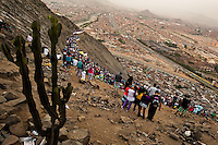 Crowds of catholic followers watch the Good Friday procession climbing the hill of San Cristobal during the Holy week in Lima, Peru, 30 March 2013. The annual Passion Of Christ procession, held as part of Easter celebrations, starts in Lima downtown and, followed by thousands of catholic believers, it climbs to the top of the dry and rocky hill of San Cristobal, where Mario Valencia, who has been playing the role of Jesus Christ for more than 30 years, is symbolically crucified.