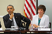 From left, United States President Barack Obama and advisor Valerie Jarrett with company executives and their small business suppliers, in the Eisenhower Executive Office Building in Washington, D.C., July 11, 2014.  The President planned to announce the creation of 'SupplierPay,' a new partnership with the private sector aimed at strengthening small businesses by increasing their working capital.<br /> Credit: Drew Angerer / Pool via CNP