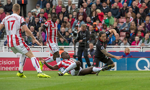 19th August 2017, bet365 Stadium, Stoke-on-Trent, England; EPL Premier League football, Stoke City versus Arsenal; Hector Bellerin of Arsenal is tackled by Kurt Zouma of Stoke City