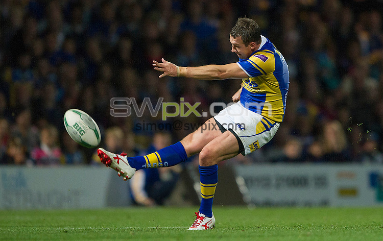 Picture by Allan McKenzie/SWpix.com - 20/09/2013 - Rugby League - Super League Plsyoff's - Leeds Rhinos v St Helens - Headingley Carnegie Stadium, Leeds, England - Leeds's Danny Mcguire kicks the drop goal to win the game.