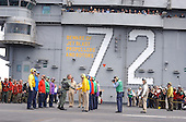 "United States President George W. Bush greets Sailors on the ""Rainbow Sideboys"" detail after successfully trapping aboard the USS Abraham Lincoln (CVN 72) in a S-3B Viking assigned to the Blue Wolves of Sea Control Squadron Three Five (VS-35) designated ""NAVY 1"" on May 1, 2003. President Bush is the first sitting President to trap aboard an aircraft carrier at sea. The President is conducting a visit aboard ship to meet with the Sailors and will address the Nation as Lincoln prepares to return from a 10-month deployment to the Arabian Gulf in support of Operation Iraqi Freedom. <br /> Credit: United States Navy via CNP"