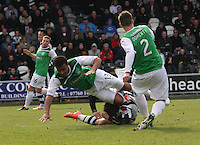 Graham Carey on the ground collides with Thomas Soares in the St Mirren v Hibernian Clydesdale Bank Scottish Premier League match played at St Mirren Park, Paisley on 29.4.12.