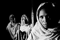 Beatings, extortion and the seizure of their homes in Burma forced these women and 120 families from their village to flee Burma in early 2009. (2009)