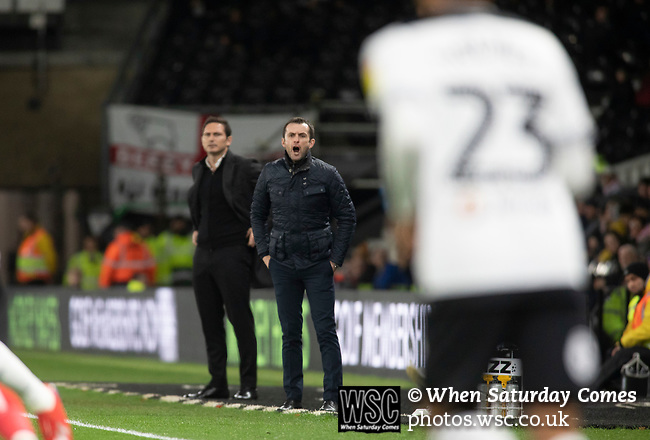 Visiting manager Nathan Jones (right) and his opposite number Frank Lampard watching the first-half action as Derby County (in white) played Stoke City in an EFL Championship match at Pride Park Stadium. Opened in 1997, it is the 16th-largest football ground in England and the 20th-largest stadium in the United Kingdom. The fixture ended in a 0-0 draw watched by a crowd of 25,685.