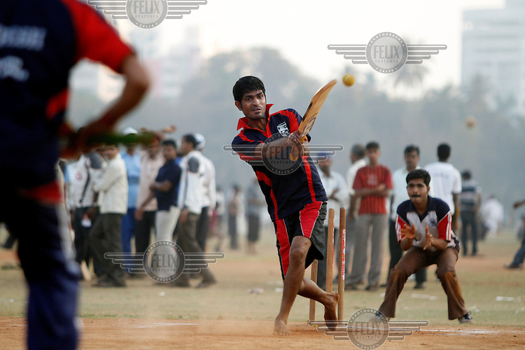 Young men and boys play cricket at the Oval Maidan, situated in South Mumbai. The shape of the ground is responsible for its name.
