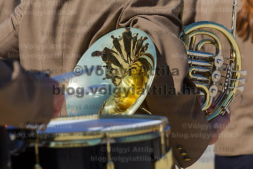 Members of the military music band are reflected on an instrument in Papa (about 165 km west of Budapest), Hungary on July 01, 2013. ATTILA VOLGYI