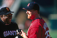 SAN FRANCISCO, CA - Mark McGwire of the St. Louis Cardinals jokes with San Francisco Giants manager Dusty Baker before a game at Candlestick Park in San Francisco, California in 1998. Photo by Brad Mangin