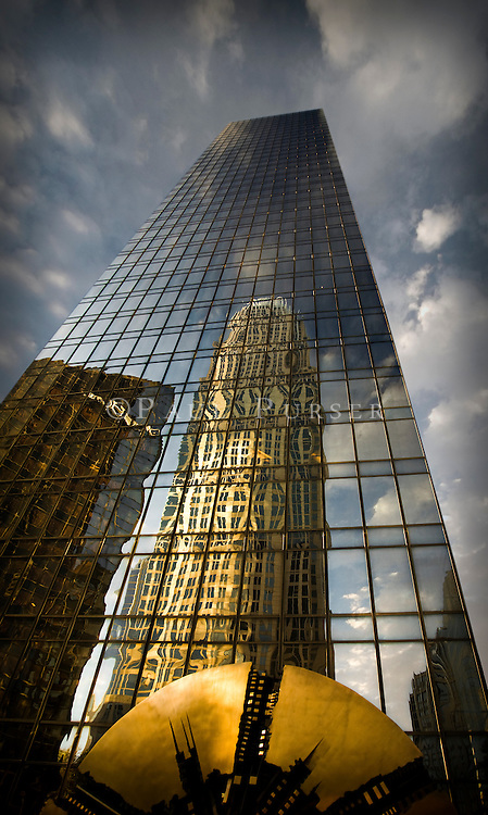 Charlotte NC: The Bank Of America Building reflecting off of the Wachovia Building, one of the coolest images of Charlotte NC in my opinion.