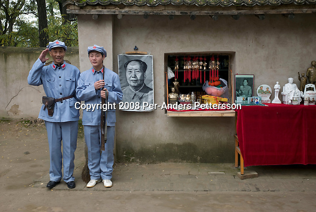 YAN'AN, CHINA OCTOBER 7: Chinese tourists dress up as Mao Tse-tung outside his house at the Zao'yuan Revolutionary Site Park on October 7, 2008 in central Yan'an, China. The city has become a popular place for communist pilgrims, as it was the endpoint for the Long March and the center of the Chinese Communist revolution from 1935 to 1948. Chinese communists celebrate Yan'an as the birthplace of the revolution. Maos's house can also be visited. Chinese people love theme parks and new ones are opening constantly. It's estimated that there's about 2400 theme parks in the country. (Photo by Per-Anders Pettersson) ...