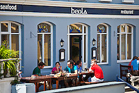 Tourists at Beola seafood restaurant in Roundstone, Connemara, County Galway, Ireland