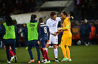 Lorient, France. - Sunday, February 8, 2015:  Abby Wambach (20) of the USWNT and goalkeeper Sarah Bouhaddi (16) of France. France defeated the USWNT 2-0 during an international friendly at the Stade du Moustoir.