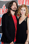 Musician Dave Grohl of the Foo Fighters and wife Jordyn Blum arrive at the 2008 VH1 Rock Honors: The Who at Pauley Pavilion on the UCLA Campus on July 12, 2008 in Westwood, California. California.