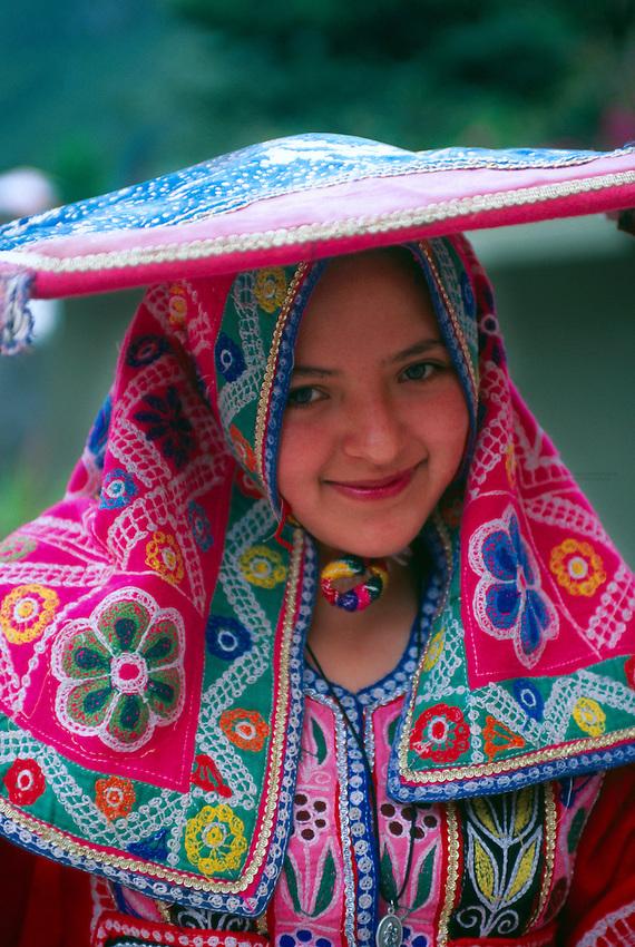 Peruvian woman in native costume, Machu Picchu archaeological site, Peru