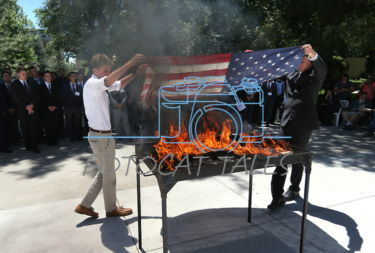 The American Legion Carson City Post 4 and members of Boys State retire American flags at a ceremony at the Capitol, in Carson City, Nev., on Friday, June 27, 2014.<br /> Photo by Cathleen Allison