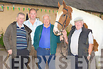 WALKING:Tom McCarthy (Tralee) walks his horse at with the help of some of his friends at the Camp Fair on Friday. l-r: Tom Egan (Tralee),.Jeremy McElligott (Spa), Tpom McCarthy (tralee) and Paddy O'Sullivan (Killarney)..