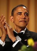 United States President Barack Obama applauds during the annual White House Correspondent's Association Gala at the Washington Hilton Hotel, Washington, DC, Saturday, April 30, 2011..Credit: Martin Simon / Pool via CNP