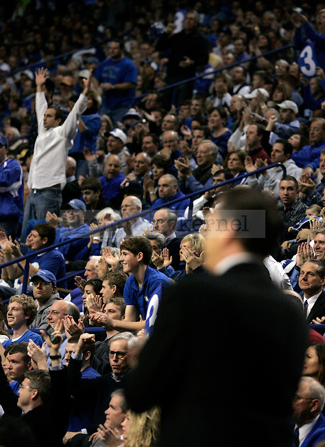 Fans cheer as Calipari yells in the first half of UK's 2000th win against Drexel at Rupp Arena on Monday, Dec 21, 2009. Photo by Britney McIntosh | Staff