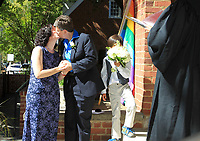 From left, Catherine Paige Gillespie kisses Andre Avis Hakes alongside Mason Hakes, 8, and Judge Jannene Shannon after becoming the first official same-sex couple to marry outside the Charlottesville Circuit Court Monday in Charlottesville, Va. The U.S. Supreme Court decided not to take up a Fourth Circuit Court of Appeals ruling that overturned the Commonwealthís ban on same-sex marriages effectively clearing the way for same-sex marriage in Virginia and four other states on Monday morning.  Photo/The Daily Progress/Andrew Shurtleff
