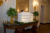 "The 2017 White House Christmas decorations, with the theme ""Time-Honored Traditions,"" which were personally selected by first lady Melania Trump, are previewed for the press in Washington, DC on Monday, November 27, 2017. Pictured is the traditional Gingerbread House that boasts 200 pounds (90.7185 kilograms) of gingerbread; 20 pounds (9.07185 kilograms) of chocolate; and 20 pounds (9.07185 kilograms) of icing and is not meant to be eaten.<br /> Credit: Ron Sachs / CNP"