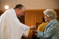 "Evelyn Morton, of Weymouth, Mass., receives communion from Father William J. Manseau at St. Frances Xavier Cabrini Church in Scituate, Mass., on Sun., May 29, 2016. Members of the congregation have been holding a vigil for more than 11 years after the Archdiocese of Boston ordered the parish closed in 2004. For 4234 days, at least one member of Friends of St. Frances X. Cabrini has been at the church at all times, preventing the closure of the church. May 29, 2016, was the last service held at the church after members finally agreed to leave the building after the US Supreme Court decided not to hear their appeal to earlier an Massachusetts court ruling stating that they must leave. The last service was called a ""transitional mass"" and was the first sanctioned mass performed at the church since the vigil began."