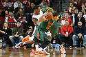 December 4, 2013: Deverell Biggs (1) of the Nebraska Cornhuskers caught in the middle between Manu Lecomte (20) and Tonye Jekiri (23) of the Miami (Fl) Hurricanes at the Pinnacle Bank Areana, Lincoln, NE. Nebraska defeated Miami 60 to 49.