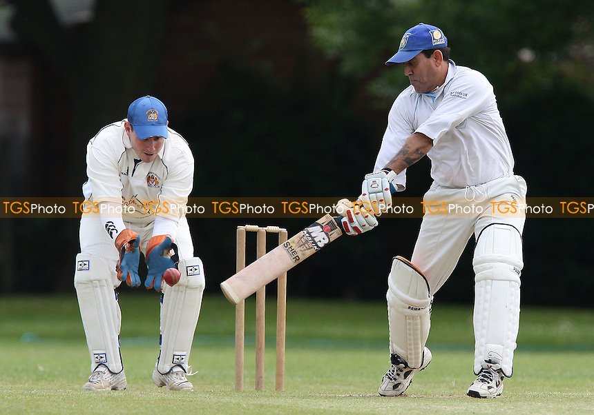Shahid Iqbal in batting action for Asian as Ben Jones keeps wicket for Hornchurch Ath - Hornchurch Athletic CC vs Asian CC - Lords International Cricket League - 13/06/09 - MANDATORY CREDIT: Gavin Ellis/TGSPHOTO - Self billing applies where appropriate - 0845 094 6026 - contact@tgsphoto.co.uk - NO UNPAID USE.