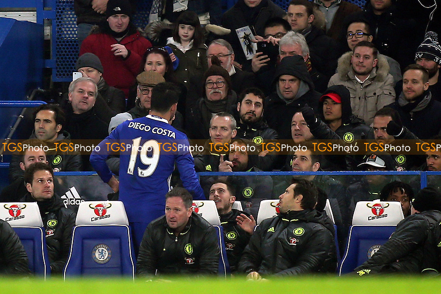 Diego Costa talks with the Chelsea coaching staff and players including Eden Hazard and John Terry after being substituted in the second half during Chelsea vs Hull City, Premier League Football at Stamford Bridge on 22nd January 2017