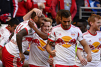 Thierry Henry (14) of the New York Red Bulls celebrates scoring with teammates  during the second half against the Colorado Rapids. The New York Red Bulls and the Colorado Rapids played to a 1-1 tie during a Major League Soccer (MLS) match at Red Bull Arena in Harrison, NJ, on March 15, 2014.