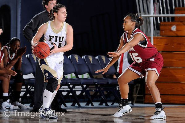 9 January 2010:  FIU's Carmen Miloglav (24) handles the ball while being defended by Troy's Cortney Hawkins (45) in the first half as the Troy Trojans defeated the FIU Golden Panthers, 61-59, at the U.S. Century Bank Arena in Miami, Florida.