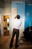 Washington, DC - January 19, 2009 -- United States President-elect Barack Obama paints walls at the Sasha Bruce House in Washington, D.C., U.S., Monday, January 19, 2009.   .Credit: Joshua Roberts - Pool via CNP