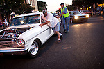 "A disabled car is pushed to the side while cruising the streets of Modesto, California during the American Graffiti Parade, June 7, 2013. Modesto is celebrating the 40th anniversary of the film ""American Graffiti"", with a parade headed up by native son, filmmaker George Lucas."