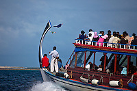 A packed Dohni heads across the lagoon in the Maldives (Monday, June 8th, 2009). Photo: joliphotos.com