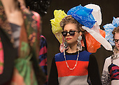 "Monday, 18 February 2013, London, UK. Fashion designer Louise Gray presents her ""Hey Crazy"" AW13 collection which involved the models wearing curlers and everyday household items. The show took place at the Topshop Show Space, The Tanks, Tate Modern, London. Photo: Bettina Strenske"