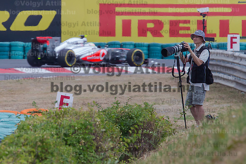 Photographers take pictures during the Hungarian F1 Grand Prix in Mogyorod (about 20km north-east from capital city Budapest), Hungary on July 27, 2013. ATTILA VOLGYI