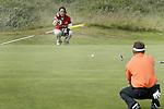 NOORDWIJK - winnaar Niels Kraaij met caddie Marie-Louise Weeda (l) . Stern Open (Nationaal Open) op de Noordwijkse GC . Foto Koen Suyk