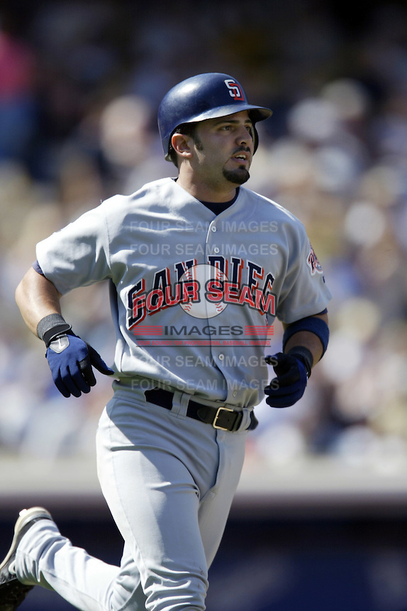 Wil Nieves of the San Diego Padres runs the bases during a 2002 MLB season game against the Los Angeles Dodgers at Dodger Stadium, in Los Angeles, California. (Larry Goren/Four Seam Images)