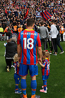 James McArthur of Crystal Palace stands with his 2 children as fans chant his name during the EPL - Premier League match between Crystal Palace and West Bromwich Albion at Selhurst Park, London, England on 13 May 2018. Photo by Carlton Myrie / PRiME Media Images.