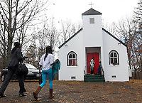 Families makes their way to the Sunday service at the small Africa Lighthouse Baptist Temple near Stony Point in Albemarle County, VA. The small 10 family congregation is made up of African refugees and immigrants who's service is spoken in Swahili and translated into English. They've just signed a rent-own lease for a small church after meeting for three years at a local school. Photo/Andrew Shurtleff