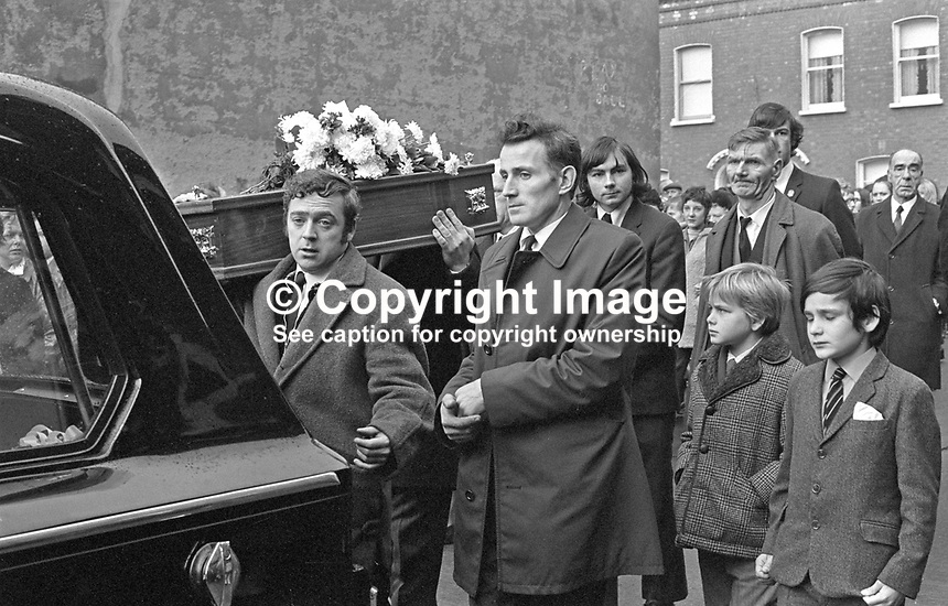 Funeral of 17 months old Tracey Munn, of Alloa Street, Belfast, N Ireland, UK. Tracey was one of two children who died in a no warning Provisional IRA attack at a Shankill Road furniture store on 11th December 1971. The other child was 17 months old Colin Nicholl, of Colin Nicholl of Elimgrove Street, Belfast. The two funerals joined up in Clifton Park Avenue on the way to the cemetery. 197112140534b. Extreme right in photo is legendary Shankill Road Unionist MP John McQuade in dark overcoat, a former professional boxer who fought under the name Jack Higgins.<br />