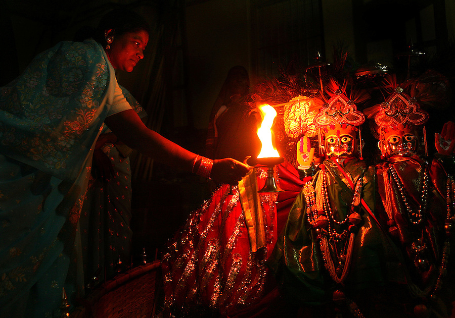 "A Devadasi woman worships the goddess, Yellamma, at a temple in Maharashtra, India. The Devadasi tradition of which she is a product,  involves the ""marrying"" of young girls from impoverished families to the goddess Yellamma.  Oncea young girl is married to Yellamma, she is regarded as a servant to the goddess and must perfrom temple duties as well as satisfy the sexual needs of the priests and other men.  She may no longer marry a mortal and may end up being sold by unscrupulous priests to pimps who will take her to work in the red-light districts of India's urban areas."