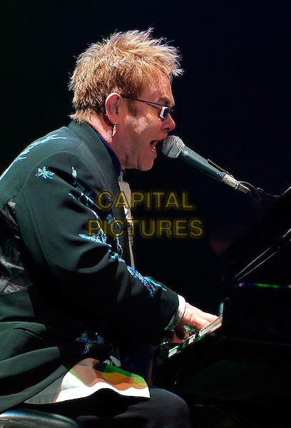 "SIR ELTON JOHN.performs as a part of his ""The Captain & The Kid Tour""  held at the Mellon Arena.  Pittsburgh, Pennsylvania, USA,.06 October 2006..concert music gig on stage live half length playing piano profile.Ref: ADM/JN.www.capitalpictures.com.sales@capitalpictures.com.©Jason L Nelson/AdMedia/Capital Pictures."