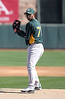 Yadel Marti #70 of the Oakland Athletics participates in spring training workouts at the Athletics complex on February 16, 2011  in Phoenix, Arizona. .Photo by:  Bill Mitchell/Four Seam Images.