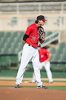 Kannapolis Intimidators starting pitcher Spencer Adams (12) looks to his catcher for the sign against the Hickory Crawdads at CMC-Northeast Stadium on May 21, 2015 in Kannapolis, North Carolina.  The Intimidators defeated the Crawdads 2-0 in game one of a double-header.  (Brian Westerholt/Four Seam Images)