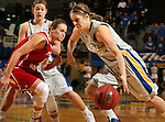BROOKINGS, SD - FEBRUARY 2:  Tara Heiser #12 from South Dakota State drives against Tia Hemiller #4 from the University of South Dakota in the first half of their game Sunday afternoon at Frost Arena in Brookings. (Photo by Dave Eggen/Inertia)