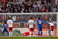 New York Red Bulls goalkeeper Luis Robles (31) fails to stop the penalty kick of Vicente Sanchez (7) of the Colorado Rapids. The New York Red Bulls and the Colorado Rapids played to a 1-1 tie during a Major League Soccer (MLS) match at Red Bull Arena in Harrison, NJ, on March 15, 2014.