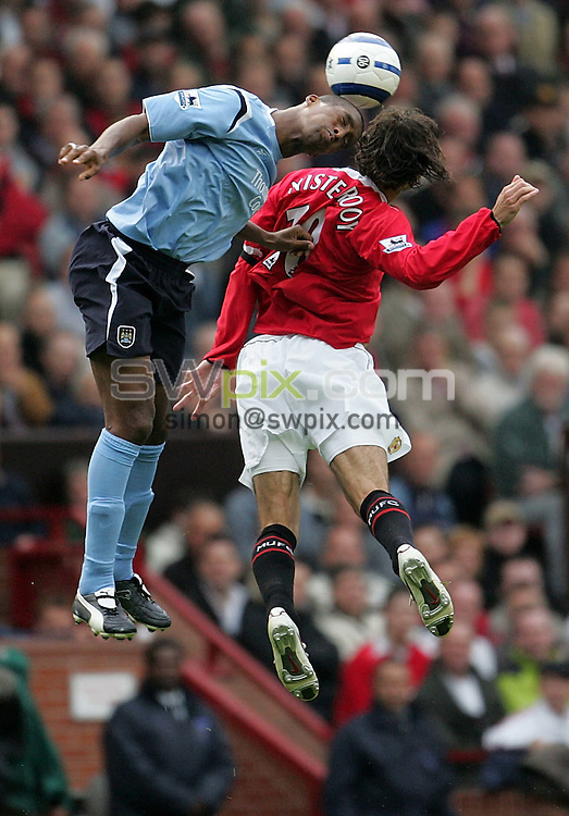 Pix by JOHN CLIFTON/SWpix.com - Football, Premiership, Manchester United v Manchester City, Old Trafford, Manchester, 10/09/05..Picture Copyright >> Simon Wilkinson >> 07811267706..Manchester City's Sylvain Distin head the ball with Manchester United's Ruud van Nistelrooy