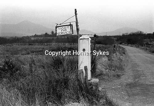 Hoot for service petrol pump. Co Kerry Eire Southern Ireland. 1972.