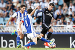 Real Sociedad's David Concha (l) and Mikel Gonzalez (c) and Real Madrid's Alvaro Morata during La Liga match. August 21,2016. (ALTERPHOTOS/Acero)