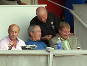 Washington, D.C. - July 4, 2007 -- United States President George W. Bush chats with Nationals part owner Mark Lerner, 2nd right, as the Chicago Cubs play the Washington Nationals at RFK Stadium in Washington on Thursday, July 7, 2007. With Bush, center, are Nationals President Stan Kasten, left, and Nationals General Manager Jim Bowden, right. <br /> Credit: Roger L. Wollenberg - Pool via CNP