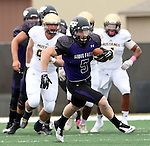 SIOUX FALLS, SD - OCTOBER 18: Brady Rose #5 from the University of Sioux Falls rooks for running room past Southwest Minnesota State in the first half of their game Saturday afternoon at Bob Young Field in Sioux Falls. (Photo by Dave Eggen/Inertia)